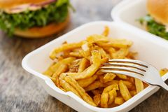 Delicious burgers on the table Royalty Free Stock Photos