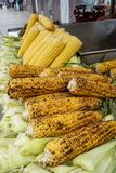 Delicious burnt fire grilled sweet yellow corn with salt flake on cob pile as street food, Istanbul stock images