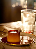 Delicious burnt sugar cream. With fruit syrup Stock Photography