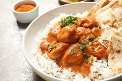 Delicious butter chicken with rice in plate on table royalty free stock images