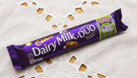 A delicious Cadbury milk chocolate bar in bright colourful packaging ready for eating Stock Image