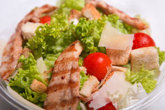 Delicious Caesar salad with chicken meat Stock Photos