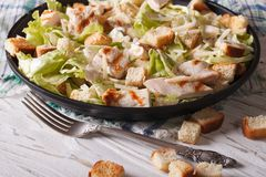 Delicious Caesar salad with grilled chicken breast horizontal Stock Images