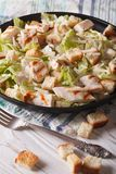 Delicious Caesar salad with grilled chicken breast vertical Royalty Free Stock Photo