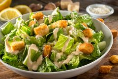 Traditional Caesar Salad. Delicious caesar salad with parmesan cheese, homemade croutons and dressing stock photo