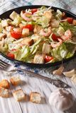 Delicious Caesar salad with shrimp close-up. Vertical Stock Image