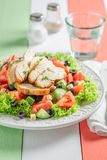 Delicious Caesar salad with tomatoes, cucumber and chicken stock photo