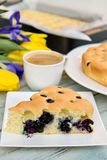 Delicious cake with blueberry and lemon flavor. Sweet breakfast with coffee, cake and flowers Stock Photos