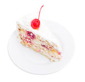 Delicious cake with cocktail cherry and coconuts. Stock Photography