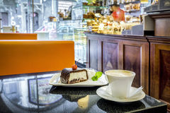 Delicious cake and coffee in a cafe place Royalty Free Stock Photos
