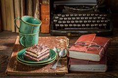 Delicious cake and coffee on desk writer Royalty Free Stock Photos