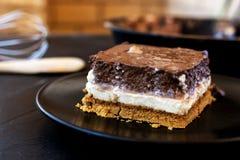 Delicious cake composed of three chocolates. White chocolate, milk chocolate and dark chocolate stock photo