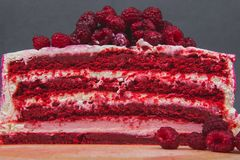 A delicious cake decorated with raspberries on a gray background. stock photo