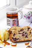 Delicious cake with fresh cherries and cup of tea Royalty Free Stock Photography