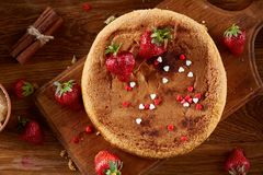 Delicious cake with fresh organic strawberries and mint, top view, close-up, selctive focus.