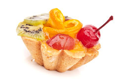Delicious cake with fruit. On a white background Stock Images