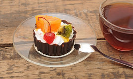 Delicious cake with fruit. And a cup of tea Royalty Free Stock Image