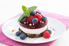 Delicious cake with fruit jelly and fresh berries Stock Images