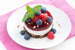 Delicious cake with fruit jelly and fresh berries on a plate. Top view Royalty Free Stock Photography