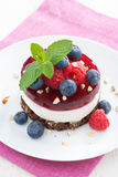 Delicious cake with fruit jelly and fresh berries, top view. Vertical Royalty Free Stock Images