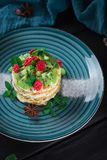 Delicious cake with fruit and mint decoration on black background.  Stock Photography