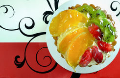 Delicious cake with fruits. On a plate Royalty Free Stock Photos