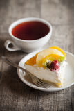 Delicious cake and hot tea Stock Image