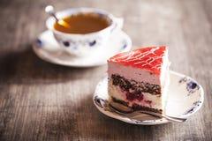 Delicious cake and hot tea Stock Photos