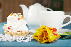 Delicious cake with jellies, tulip flower, cup of tea and teapot Stock Photos