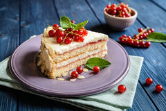 Delicious cake with mascarpone, whipped cream, red currant and almond slices. Delicious cake filled with mascarpone, whipped cream, red currant jam and decotated stock photo