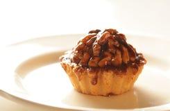 Delicious cake with nut, chokolate and caramel. Stock Image