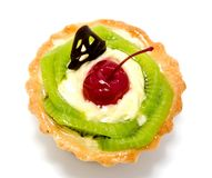 Delicious cake pastry with fruit cherry kiwi isolated. On a white background Stock Photography