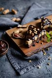 Delicious cake with peanut butter cream and chocolate topping stock image