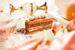 Delicious cake with peanuts on beautiflly decorated table Royalty Free Stock Photography
