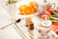 Delicious cake with peanuts on beautiflly decorated table Royalty Free Stock Image