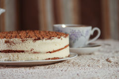 Delicious cake on a plate and tea. Improper diet Royalty Free Stock Photography