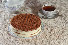 Delicious cake on a plate and tea. Improper diet Royalty Free Stock Photo