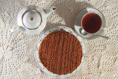 Delicious cake on a plate and tea. Improper diet Stock Photography