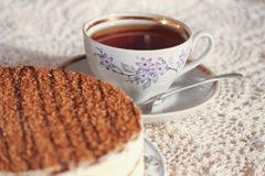 Delicious cake on a plate and tea. Improper diet Stock Photo