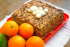 Delicious cake on a platter and fruit. Royalty Free Stock Photography