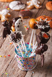 Delicious cake pop Halloween in a bucket on the table. vertical Stock Photos