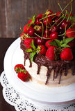 Delicious cake with strawberry, cherry and chocolate decoration Stock Photo