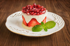 Delicious cake with strawberry and pomegranate Royalty Free Stock Photo