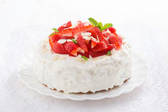 Delicious cake with whipped cream and strawberries Royalty Free Stock Image