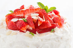 Delicious cake with whipped cream and strawberries, close-up Royalty Free Stock Images