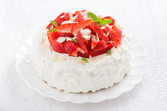 Delicious cake with whipped cream and strawberries on a plate Royalty Free Stock Photography