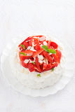 Delicious cake with whipped cream and strawberries, vertical Royalty Free Stock Images