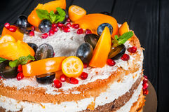 Cake on a black background. Delicious cake on a wooden black background Stock Photo