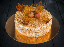 Cake on a black background. Delicious cake on a wooden black background Royalty Free Stock Images