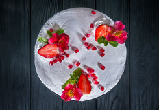 Cake on a black background. Delicious cake on a wooden black background Stock Photos